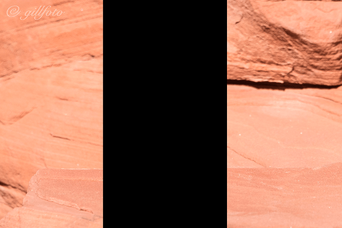 Red rock face with black rectangle in the middle